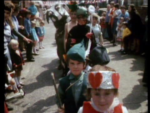 fancy dress parade in street party to celebrate the jubilee silver jubilee celebrations 07 june 77 - street party stock videos & royalty-free footage