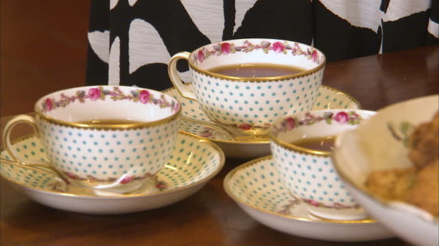 fancy tea cups and tea - afternoon tea stock videos & royalty-free footage