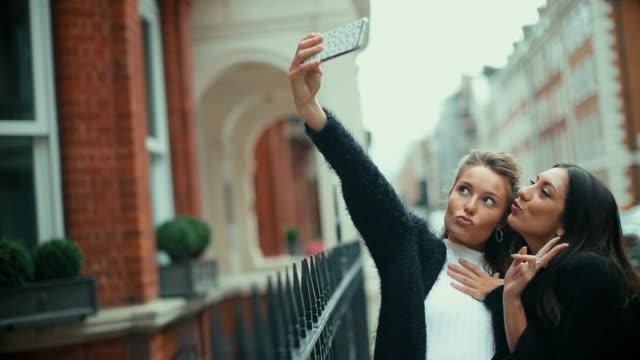 Fancy women in London take a selfie
