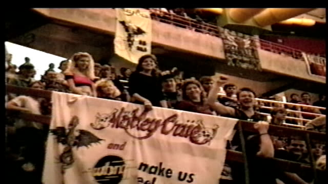 fans and concert goers before a motley crue rock concert - anno 1990 video stock e b–roll