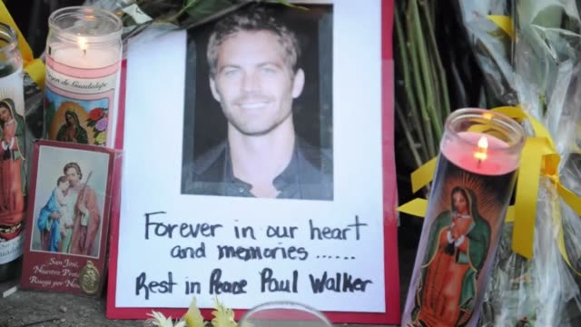 fans and fellow actors mourn the death of paul walker best known as undercover agent brian o'connor in the fast and furious action movies in a car... - santa clarita video stock e b–roll