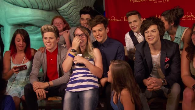 Fans and One Direction Wax Figures of Niall Horan Zayn Malik Liam Payne Harry Styles Louis Tomlinson at Madame Tussauds New York Unveils One...