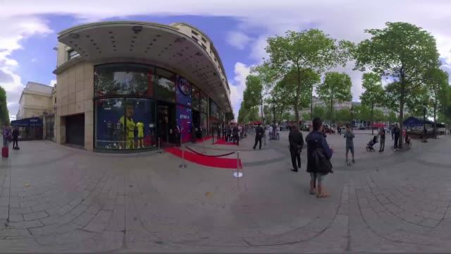 fans and supporters await neymar jr arrival at champselysees outside a football store - neymar da silva stock-videos und b-roll-filmmaterial