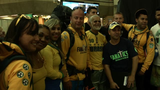 fans are seen exiting the international flight terminal at rio de janeiro galeao international airport, shot on the 10th of june, 2014 - australian national team stock videos & royalty-free footage
