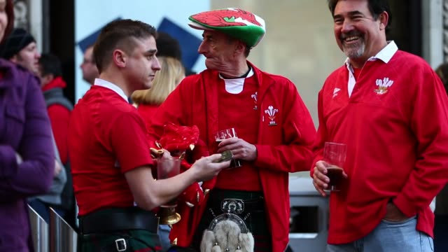 fans arrive at the millennium stadium in cardiff february 2 2013 for the six nations rugby match between wales and ireland rugby fans arrive at the... - millennium stadium stock videos & royalty-free footage