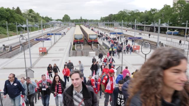 Fans arriving from the train station on the way to the stadium ahead of the DFB Cup Final 2019 between RB Leipzig and Bayern Muenchen at...
