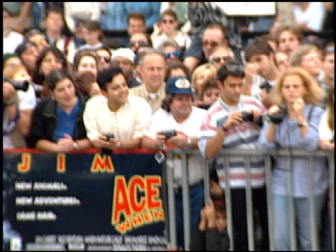 stockvideo's en b-roll-footage met fans at the dedication of jim carrey's footprints at grauman's chinese theatre in hollywood, california on november 2, 1995. - mann theaters