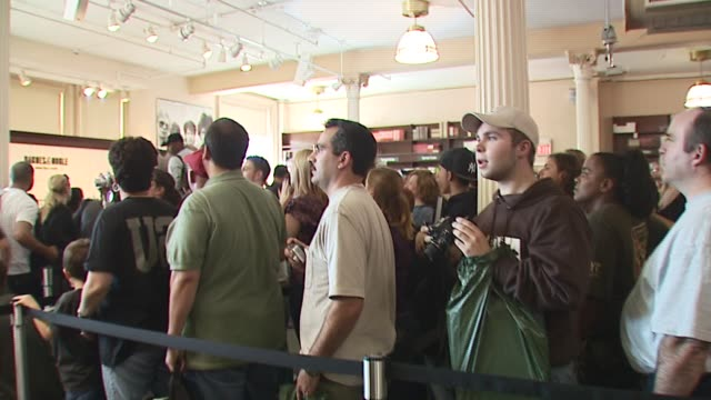 fans at the u2 signs copies of their new book 'u2 by u2' at barnes noble union square in new york new york on september 26 2006 - barnes & noble stock videos and b-roll footage