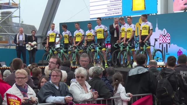 fans attend the official presentation of the tour de france riders two days before the official start of the race in mont saint michel - la manche stock videos and b-roll footage