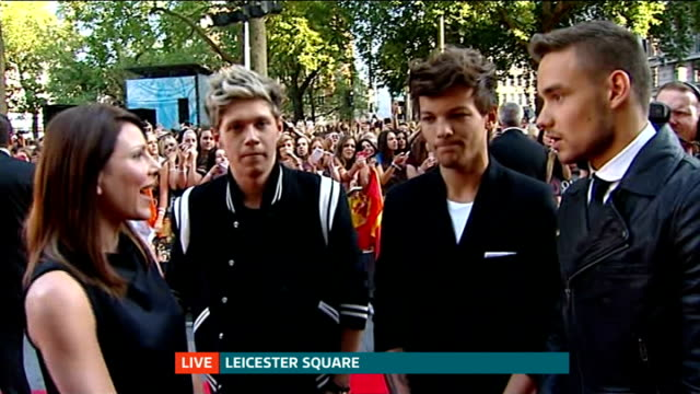 Fans camp out for premiere of One Direction film 'This is Us' ENGLAND London EXT Liam Payne Louis Tomlinson and Niall Horan LIVE red carpet interview...