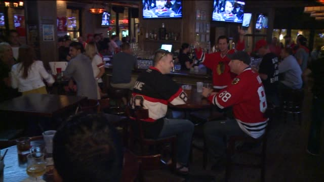 WGN Fans Celebrate Blackhawks Win At Bar on June 12 2013 in Chicago Illinois