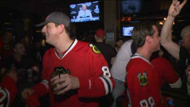 WGN Fans Celebrate Chicago Blackhawks Win on June 12 2013 in Chicago Illinois
