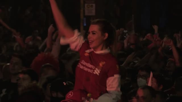 fans celebrate in to friday morning outside anfield after liverpool won the premier league title for the first time in 30 years - winning stock videos & royalty-free footage