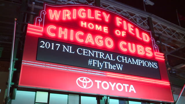 wgn fans celebrated in front of wrigley field after a 51 victory in st louis on sept 27 the cubs officially eliminated the brewers from contention... - elimination round stock videos and b-roll footage
