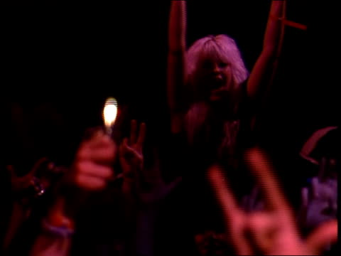 vídeos de stock, filmes e b-roll de fans cheer and holding up lighters at rock concert in 1988 - ritz carlton hotel