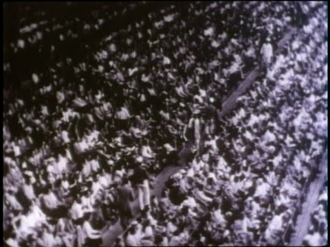 fans cheer as jackie robinson plays baseball with the brooklyn dodgers. - anno 1947 video stock e b–roll