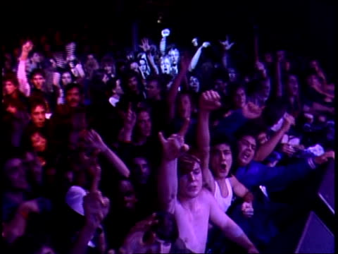 vídeos de stock, filmes e b-roll de fans cheer in crowd at rock concert in 1988 - ritz carlton hotel