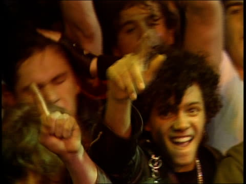 vídeos de stock, filmes e b-roll de fans cheering at front of stage at rock concert in 1988 - ritz carlton hotel