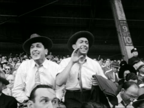 b/w 1941 fans cheering heckling in stands / yankees vs dodgers world series / ebbets field ny - ebbets field video stock e b–roll