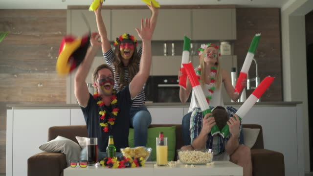 fans cheering teams of germany and italy