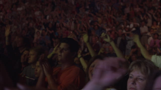 fans dance and sing during a concert. - concert hall stock videos and b-roll footage