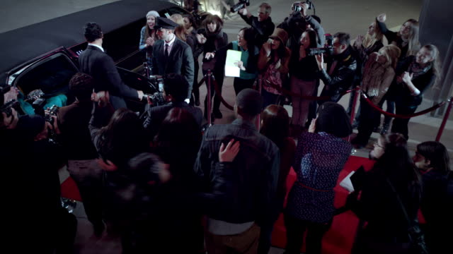 fans flock to red carpet crowd as celebrity couple arrive at world premiere at awards show - grammy awards stock videos and b-roll footage