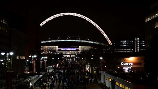 fans flock to wembley stadium in london, february 6, 2013 for the the england v brazil international friendly football match, february 6, 2013. fans... - wembley stadium stock videos & royalty-free footage