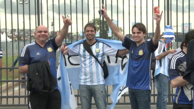 fans from holland and argentina are arriving at the corinthians arena in sao paulo ahead of their semi final clash - oranje stock videos & royalty-free footage