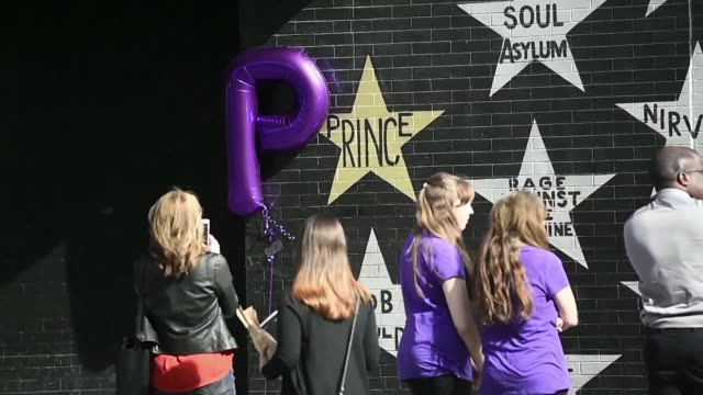 fans gather at paisley park and first avenue nightclub in minnesota to honor and remember music icon prince who died one year ago - prince stock videos & royalty-free footage