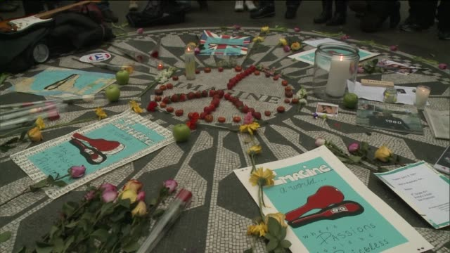 fans gather in central park at strawberry fields memorial to mourn john lennons death at central park on december 08, 2013 in new york, new york - mourning stock videos & royalty-free footage