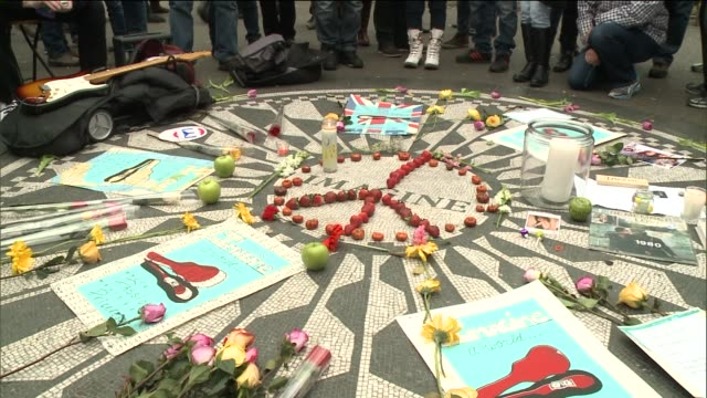 Fans Gather in Central Park at Strawberry Fields Memorial to Mourn John Lennons Death at Central Park on December 08 2013 in New York New York