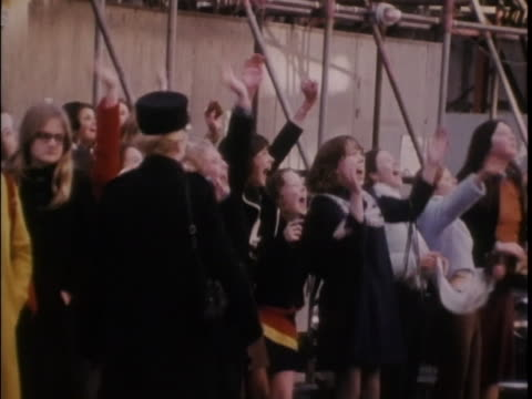fans gather on a street in the hopes of seeing the osmonds. - the osmonds stock videos & royalty-free footage