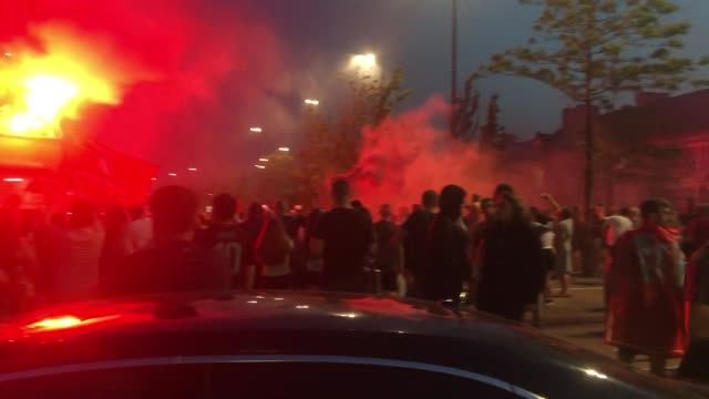 fans gather outside anfield to celebrate liverpool winning the premier league for the first time ever. liverpool's 30-year wait for a league title is... - side view stock videos & royalty-free footage