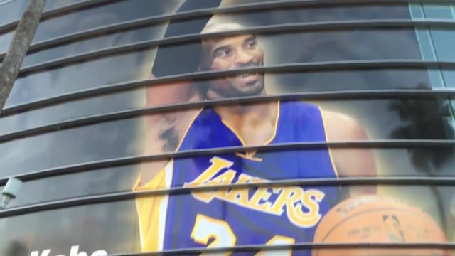 fans gather outside of the staples center for kobe bryant's last game with the lakers on april 13 2016 sots with kobe bryant fans fans signed a wall... - kobe bryant stock videos & royalty-free footage