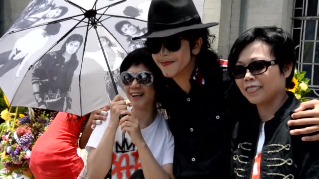 Fans gather outside the final resting place of Michael Jackson at Forest Lawn Memorial Park in Glendale California to mark the fourth anniversary of...