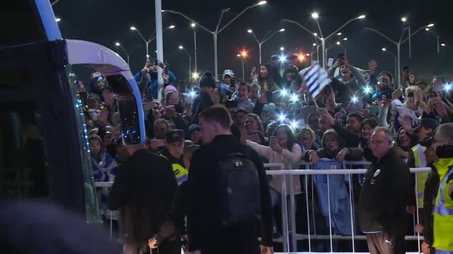 Fans greet the Uruguay national football team at the Carrasco International Airport in Montevideo before the players fly to Nizhny Novgorod Russia...