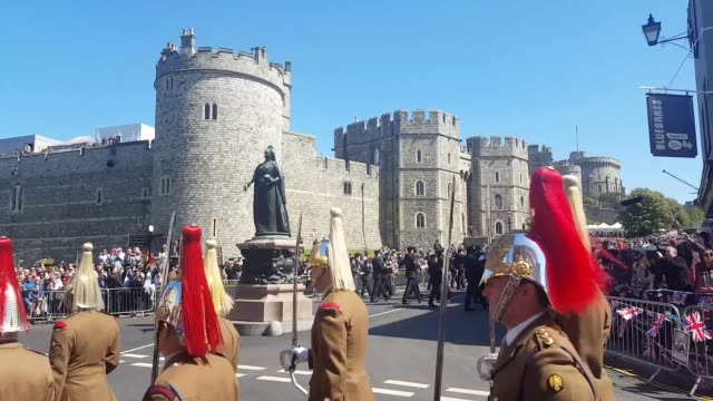 fans have gathered outside windsor castle to witness final preparations for the royal wedding of prince harry and meghan markle on saturday may 19 - meghan harry stock videos and b-roll footage