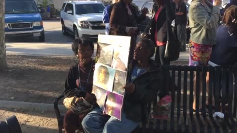 vídeos de stock e filmes b-roll de fans hold a vigil/rally in leimert park, los angeles, honoring music legend prince after his unexpected death. a couple holds a poster with images of... - final
