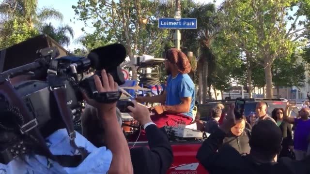 fans hold a vigil/rally in leimert park los angeles honoring music legend prince after his unexpected death a couple holds a poster with images of... - trauerzeit stock-videos und b-roll-filmmaterial