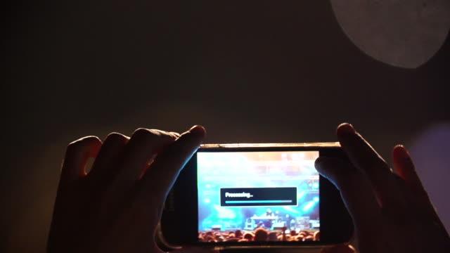 Fans Holding Smart Phones At Music Concert