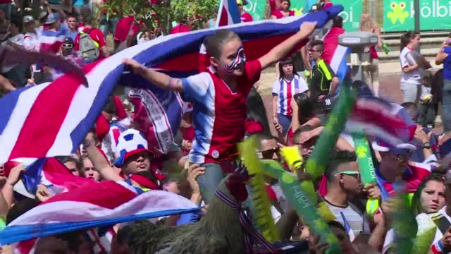 fans in costa rica stay proud as their national team takes leave of the world cup stage after a dramatic 43 penalty shoot out loss to the netherlands - oranje stock videos & royalty-free footage
