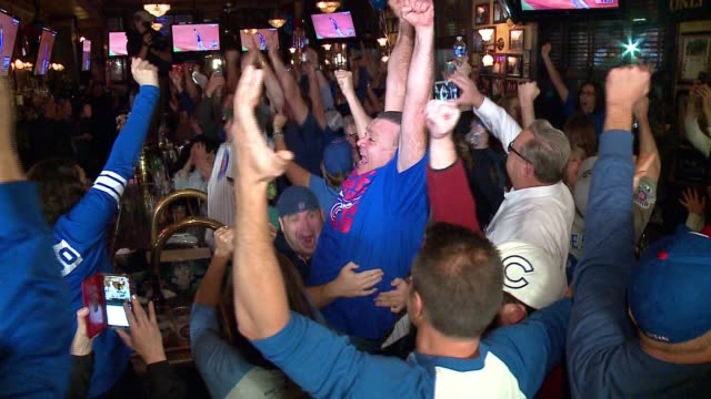 WGN Fans in Harry Caray Bar React As Chicago Cubs Win the World Series on Nov 3 2016