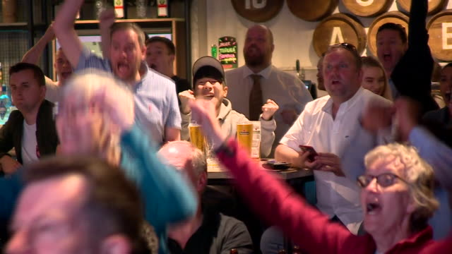 fans in liverpool watching the women's world cup semi-final between england and the usa - contestant stock videos & royalty-free footage