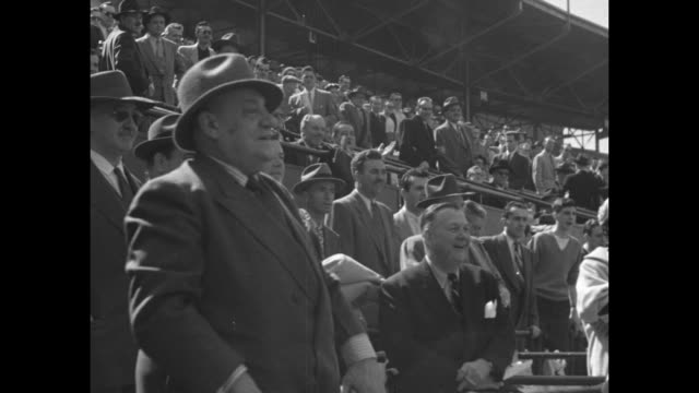 ws fans in stands at delorimier stadium in montreal / vs montreal mayor camillien houde throws out first pitch from stands / ms crowd applauds / cu... - syracuse stock videos & royalty-free footage