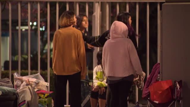 ktla fans line up outside staples center as global pop sensation bts kicks off tour in la - bts band stock videos and b-roll footage