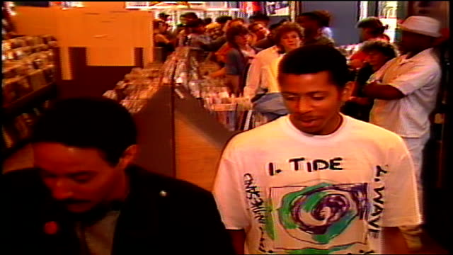 fans lined up in tower records for autographs from living colour in nyc - ミュージックショップ点の映像素材/bロール
