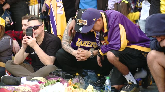 fans mourn at crowds gather outside staples center for kobe bryant memorial at staples center on january 27 2020 in los angeles california - kobe bryant stock videos & royalty-free footage