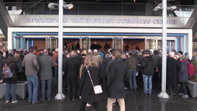 fans of bob dylan gather outside the stockholm waterfront congress centre where dylan is set to perform concerts on the first stop of a long planned... - literature stock-videos und b-roll-filmmaterial