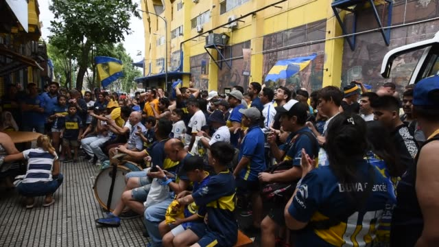 Fans of Boca Juniors watch a broadcast of the final against River Plate in La Boca during the second leg of the final match of Copa CONMEBOL...