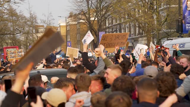 fans of chelsea football club protest against the european super league outside stamford bridge on april 20, 2021 in london, england. six english... - europe stock videos & royalty-free footage